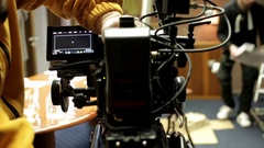 Some videocameras with operators close up recording presentation Stock Footage