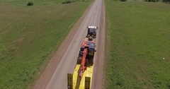 Orange digger travelling on truck with long trailer Stock Footage