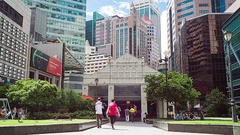 A Timelapse of Singapores Raffles Place CBD during rush hour Stock Footage
