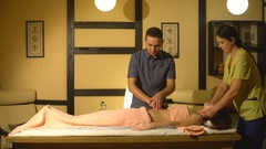 Four hands back massage Stock Footage