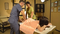Back massage with four hands in Thai massage Stock Footage