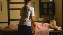 The woman doing the massage of the buttocks Stock Footage