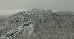 Misty Winter Aerial Flight Over ural Mountains under a cloudy sky Stock Footage