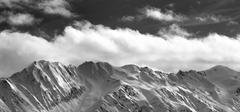 Black and white panoramic view on snow winter mountains and sunlight cloud .. Kuvituskuvat