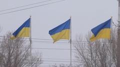 Ukrainian flags on flagpole, closeup. Symbol of Ukraine. Stock Footage
