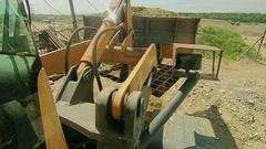 Front end bulldozer loads rocks Stock Footage