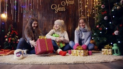 Three Amazed woman looking at magical christmas gift in the box Stock Footage