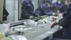 Plastic bottle on the sorting conveyor. Waste sorting. Recycling waste Stock Footage