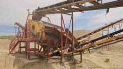 Industrial background with working gravel crusher Stock Footage