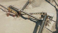 Industrial background aerial shot of a stone crushing machine Stock Footage