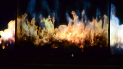 Light and shade, choreography against the background of fire. Stock Footage