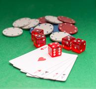 Aces chips cubes on a green background Stock Photos
