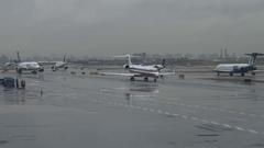 Rainy Day LGA LaGuardia Airport Tarmac Time Lapse Stock Footage