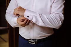 Businessman hands with cufflinks. Elegant gentleman clother Stock Photos