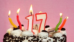 Happy 17 birthday with cake and candles on pink background Stock Footage