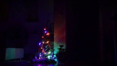 In the dark of the room. Sparkling Christmas tree. Stock Footage