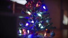 In the low-lit room, Christmas tree. Stock Footage