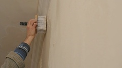 Man Gets Manually Gypsum Plaster On The Wall Stock Footage
