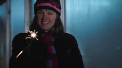 Young woman have fun with sparkler at the winter holiday Christmas and New Year Stock Footage