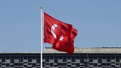 Flag of Turkey waving in wind inside Taksim square of Istanbul Stock Footage