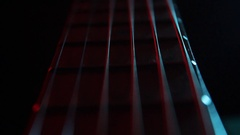 Guitar headstock on stage, magic blue lighted Stock Footage