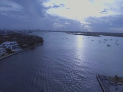 Aerial shot over bridge by water in Miami Stock Footage