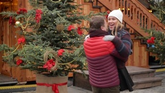 Romantic Dating Couple on the Christmas Fair, Man is Rotating his Hugged Stock Footage