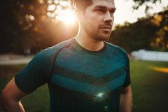 Fitness male model standing outdoors Stock Photos