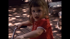 Little Girl on Tricycle rides away Stock Footage