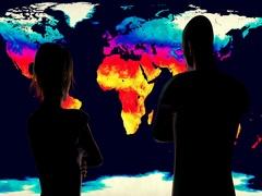 4K Woman and Man Watching Earth Landmass Global Warming Simulation Stock Footage