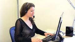 Female customer service representative at her desk Stock Footage