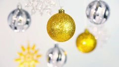 Silver and golden shining balls and snowflakes hanging on silver ropes Stock Footage
