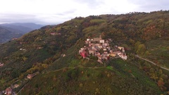 424 Aerial shot, gorgeous small village on the hill flyover, in middle of t.. Stock Footage