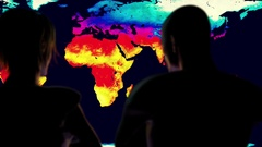 Woman and Man Watching Earth Landmass Global Warming Simulation Cinematic Cam Stock Footage