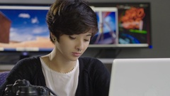 Young, hip female using photoshop on her computer Stock Footage