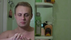 Man applying aftershave. Stock Footage