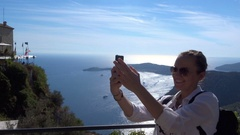 Happy girl on vacations taking self photo on sea background, riviera coast HD Stock Footage