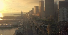 Aerial of San Francisco Ferry Building, bay bridge, Embarcadero & city at Stock Footage
