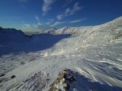 Shadow moves in a mountain valley covered in snow-timelapse Stock Footage