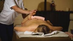 Woman having professional therapeutic legs massage Stock Footage