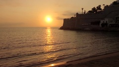 The wall of the medieval town by the sea at dawn. Aerial view. Stock Footage