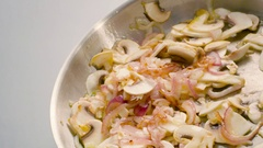 Mashrooms and onion on the pan Stock Footage