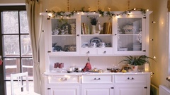 White vintage cupboard decorated for Christmas season Stock Footage