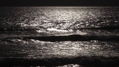 Slow motion deep seascape view with sun flecks on water surface at sunset Stock Footage