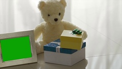 Gift box, Bear and Photo frame Stock Footage