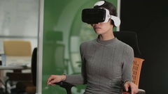Asian female Using Virtual Reality in creative office Stock Footage