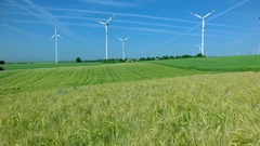 Wind farm on green field. Ecology. Green energy. Aerial view Stock Footage