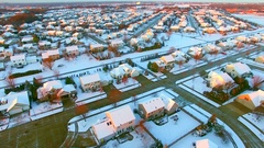 Stunning aerial view of houses, suburb under first snow. Stock Footage