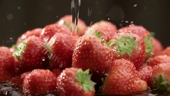 Red ripe juicy strawberries to wash with water in slow motion Stock Footage