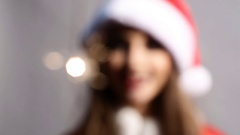 Lightening Christmas sparkler and Girl dressed as Santa Claus Stock Footage